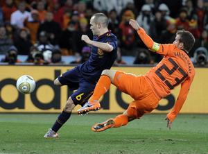 Spain's Andres Iniesta, left, scores a goal past Netherlands' Rafael van der Vaart during the World Cup final soccer match between the Netherlands and Spain at Soccer City in Johannesburg, South Africa