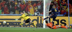 Spain's Andres Iniesta, right, scores a goal past Netherlands goalkeeper Maarten Stekelenburg, left, during the World Cup final soccer match between the Netherlands and Spain at Soccer City in Johannesburg, South Africa