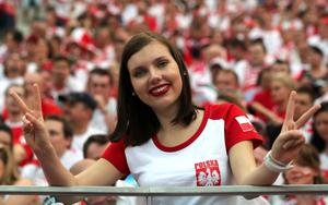 WARSAW, POLAND - JUNE 08:  A football fan smiles ahead of the UEFA EURO 2012 group A match between Poland and Greece at National Stadium on June 8, 2012 in Warsaw, Poland.  (Photo by Alex Grimm/Getty Images)