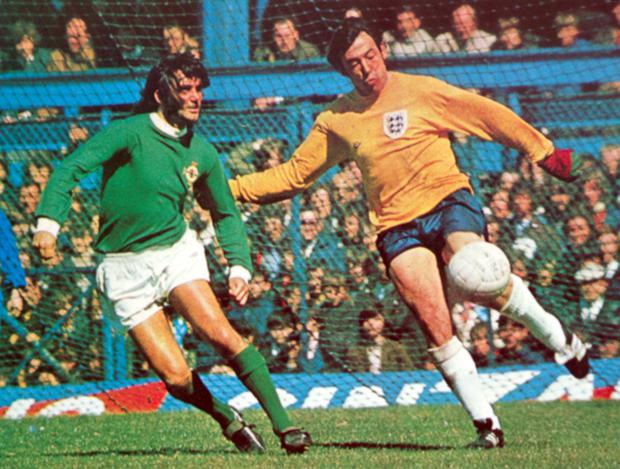George Best puts pressure on Gordon Banks as he prepares to clear the ball from the England penalty area in the 1971 international at Windsor Park.