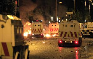 Loyalist rioters attack police in East Belfast, Northern Ireland, Wednesday, June, 22, 2011. Rioting began for the second night between Catholic and Protestant gangs. (AP Photo/Peter Morrison)