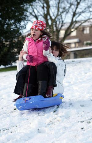 Nisha Stevenson and her mum Anne McAteer sleighing in the snow at Brooke Park, Derry