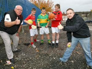 Frank Dempsey, chair of Carrick Hill Residents Association, and Mel Waddell, Groundwork NI, give the thumbs up with local sports fans for the recent funding awarded for a Multi Use Games Area