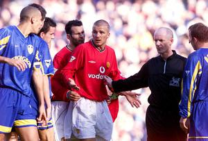 David Beckham finds himself in the middle of a melee at Elland Road during the Premiership match between Leeds United and Manchester United back in 2001