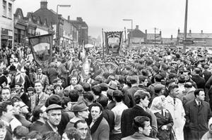 Riots : Belfast. August 1969.  Members of the Junior Orangemen pass through crowds of onlookers beside the Unity place flats at Peter's Hill.  (2/8/69)