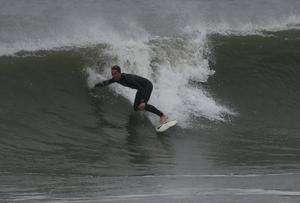 CAPE MAY, NJ - OCTOBER 28: A loader surfer takes advantage of the heavy surf caused by the approaching hurricane Sandy, on October 28, 2012 in Cape May, New Jersey. Hurricane Sandy is expected to hit the New Jersey coastline sometime on Monday bringing heavy winds and floodwaters. (Photo by Mark Wilson/Getty Images)