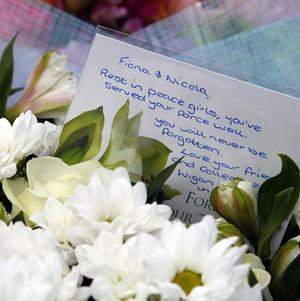 Floral tributes at the scene of this week's shooting in Hattersley, Greater Manchester