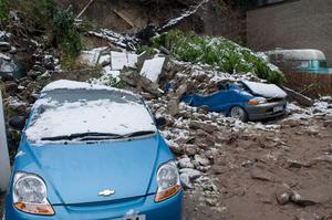 The scene at Marlborough Terrace in Londonderry where two cars and a van were crushed after a wall collapsed
