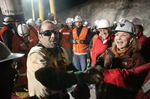 SAN JOSE MINE, CHILE - OCTOBER 12: (NO SALES, NO ARCHIVE) In this handout from the Chilean government, Mario Sepulveda, 39, is the second miner to exit the rescue capsule October 12, 2010 at the San Jose mine near Copiapo, Chile. The rescue operation has begun bringing up the 33 miners, 69 days after the August 5th collapse that trapped them half a mile underground. (Photo by Hugo Infante/Chilean Government via Getty Images)
