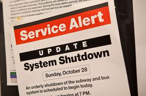 NEW YORK, NY - OCTOBER 28:  A sign announcing the temporary closure of the New York subway system, due to Hurricane Sandy, is seen in the subway prior to the arrival of Hurricane Sandy on October 28, 2012 in New York City. New York plans on shutting down the entire public transmit system starting at 7PM, Sunday night. Sandy, which has already claimed over 50 lives in the Caribbean, is predicted to bring heavy winds and floodwaters as the mid-atlantic region prepares for the damage.  (Photo by Andrew Burton/Getty Images)