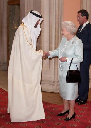 Crown Prince of Abu Dhabi Mohammed bin Zayed  is greeted by Queen Elizabeth II at a lunch for Sovereign Monarch's held in honour of Queen Elizabeth II's Diamond Jubilee, at Windsor Castle, in Windsor, Berkshire. PRESS ASSOCIATION Photo.