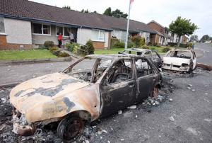 Press Eye - Belfast - Northern Ireland - 10th July 2011 - Picture by Jonathan Porter/ PressEye.com -  Overnight trouble in Ballyclare between loyalist rioters and the PSNI.  The trouble started late on Saturday night and continued into Sunday morning with a number of vehicles being highjacked and burnt out.  Burnt out cars pictured in the Grange Estate off the Doagh Road where most of the trouble occurred.
