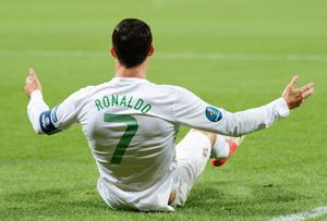 DONETSK, UKRAINE - JUNE 27:  Cristiano Ronaldo of Portugal sits on the pitch during the UEFA EURO 2012 semi final match between Portugal and Spain at Donbass Arena on June 27, 2012 in Donetsk, Ukraine.  (Photo by Jasper Juinen/Getty Images)