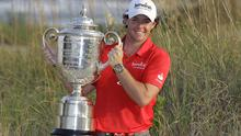 Rory McIlroy poses for photographers with the championship trophy after the final round of the PGA Championship golf tournament on the Ocean Course of the Kiawah Island Golf Resort in Kiawah Island, S.C., Sunday, Aug. 12, 2012. (AP Photo/Chuck Burton)