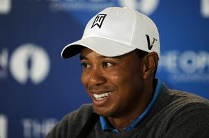 Tiger Woods addresses the media prior to the 139th Open Championship on the Old Course, St Andrews on July 13, 2010