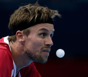LONDON, ENGLAND - JULY 31:  Michael Maze of Denmark completes during the Men's Singles Table Tennis quarter-final match against Dimitrij Ovtcharov of Germany on Day 4 of the London 2012 Olympic Games at ExCeL on July 31, 2012 in London, England.  (Photo by Feng Li/Getty Images)