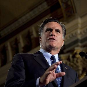 Mitt Romney urged the Republicans to shift their focus to Barack Obama after winning primaries in Wisconsin, Washington, DC and Maryland (AP)