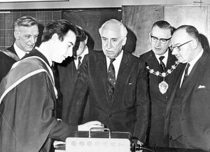 The Governor, Lord Eskine, discussing a physics experiment with Mr. G. McCullough during a tour of the classrooms after opening Ballymena Academy new premises. Also in the picture are (from left), Mr. W. H. Mol, headmaster; Alderman J. B. Millar, Major of Ballymena, and Captain William Long, Minister of Education, 1968.