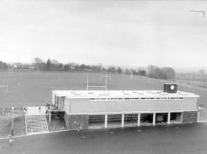 The sports pavilion with the rugby playing fields behind, 1968.