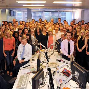 News of the World staff in the newsroom in Wapping, east London, as they work on the title's final edition