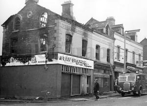 Riots : Belfast. August 1969.  Grahams betting office on the corner of Disraeli Street and Crumlin Road, which was damaged by fire.  15/8/69