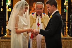 """Simon MacCabe and his bride Victoria exchange rings with Dr Wall performing the ceremony. <p><b>To send us your Wedding Pics <a  href=""""http://www.belfasttelegraph.co.uk/usersubmission/the-belfast-telegraph-wants-to-hear-from-you-13927437.html"""" title=""""Click here to send your pics to Belfast Telegraph"""">Click here</a> </a></p></b>"""