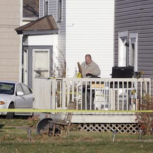 An investigator examines evidence at the home of Matthew Hoffman (AP)