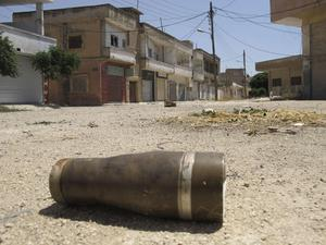 A shell is seen in a street at a residential area of Talbisah  in Homs city Syria Monday June 11, 2012. (AP Photo/David Manyua/United Nations )