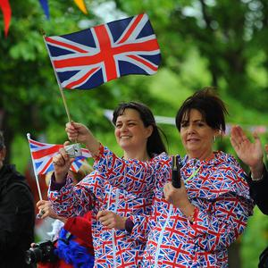 Spectators dressed in the Union Flag cheer on the Olympic Flame on the Torch Relay leg between Burnley and Rawtenstall (LOCOG/PA)