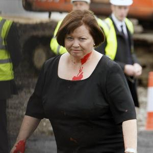 Health Minister Mary Harney TP after she was pelted with red paint in protest at health cuts