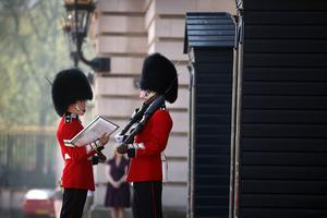 LONDON, ENGLAND - APRIL 20:  A member of the Scots Guards has his duties read to him during the Changing of the Guard ceremony at Buckingham Palace on April 20, 2011 in London, England. Soldiers guard Queen Elizabeth II and other royals at Buckingham Palace in a 24 hour rotation with a ceremonial hand over at 11.30 in the morning.  (Photo by Peter Macdiarmid - WPA Pool /Getty Images)