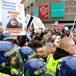 Police watch English Defence League members protesting in St George's Square, Luton