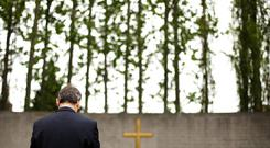 Fianna Fail leader Micheal Martin pays his respects at Arbour Hill cemetery in Dublin today during the annual Fianna Fail 1916 Easter Rising Commemoration