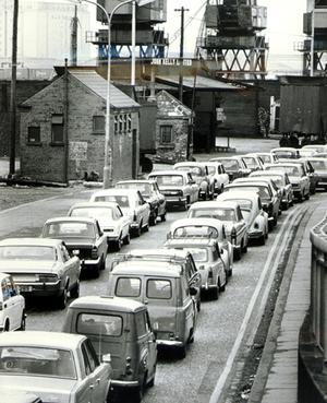 Cars queued up waiting to enter the harbour estate at Queens, Belfast, when the Army set up check points at the entrances after taking over the petrol and oil facilities. Ulster Workers Council Strike 27/05/74