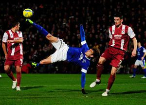 CHELTENHAM, ENGLAND - JANUARY 07:  Nikica Jelavic of Everton attempts an overhead kick as Billy Jones of Cheltenham Town (R) looks on during the FA Cup with Budweiser Third Round match between Cheltenham Town and Everton at Abbey Business Stadium on January 7, 2013 in Cheltenham, England.  (Photo by Stu Forster/Getty Images)  *** BESTPIX ***
