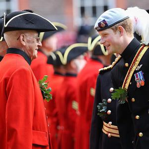Prince Harry talks with Chelsea pensioners, residents of the Royal Hospital Chelsea, who are all former service personnel