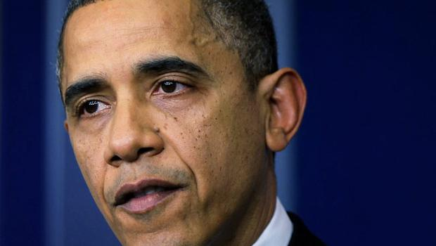 WASHINGTON, DC - DECEMBER 14:  U.S. President Barack Obama wipes tears as he makes a statement in response to the elementary school shooting in Connecticut December 14, 2012 at the White House in Washington, DC. There are 27 dead, including 20 children and the shooter. One more male was found dead in Hoboken, New Jersey, and is believed connected to the shooting.  (Photo by Alex Wong/Getty Images)