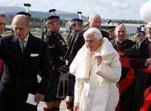 Pope Benedict XVI is met by the Duke of Edinburgh (left) as he arrives in Edinburgh, Scotland, to begin the first papal state visit to the UK