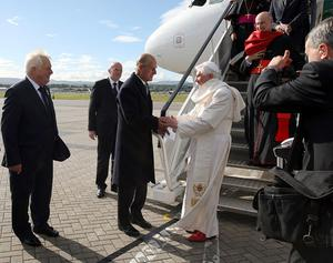 Pope Benedict XVI is met by the Duke of Edinburgh as he arrives in Edinburgh, Scotland, to begin the first papal state visit to the UK