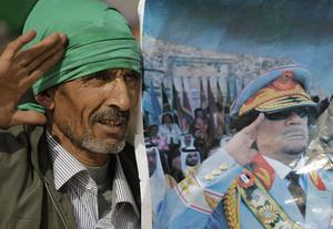 A Pro-Gadhafi supporter simulates the salute portrayed in a photograph of the Libyan Leader Moammar Gadhafi, as he and others stage a small rally, standing on the stage of the Roman amphitheatre at the Sabratha archaeological site, after following foreign journalists there who visited on a government-provided tour, in Sabratha, Libya, Monday, Feb. 28, 2011.  Gadhafi supporters said Monday that they were in control of the city of Sabratha, west of Tripoli, which has seemed to vacillate between the two camps over the past week, with some anti-Gadhafi graffiti scrawled on walls being painted over by residents. (AP Photo/Ben Curtis)