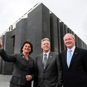 Tourism Minister Arlene Foster joins First Minister Peter Robinson, centre, and Deputy First Minister Martin McGuinness outside the new centre