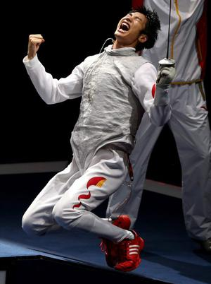 LONDON, ENGLAND - JULY 31:  Sheng Lei of China celebrates winning the Men's Foil Individual Gold Medal Bout against Alaaeldin Abouelkassem of Egypt on Day 4 of the London 2012 Olympic Games at ExCeL on July 31, 2012 in London, England.  (Photo by Hannah Johnston/Getty Images)