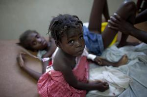 Children suffering cholera symptoms receive serum at a hospital in Marchand Dessalines, Haiti, Friday Oct. 22, 2010