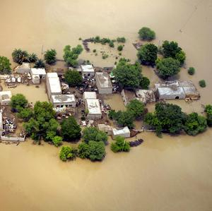 Houses and narrow surrounding are are left amid flooded waters in Kot Addu, Pakistan (AP)
