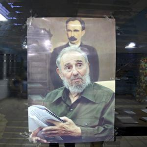 A picture of Cuba's leader Fidel Castro is seen at a polling station in Havana (AP)
