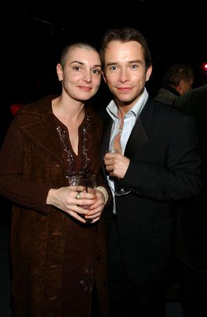 5/2/2003 of Stephen Gately and Sinead O'Connor attend a party at The Old Billingsgate Fish Market, London, following Sir Elton's benefit gig at the Old Vic Theatre