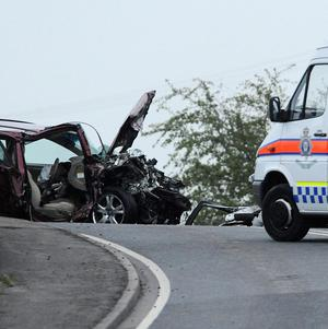 Police at the scene of a fatal car crash on the A614, close to the village of East Cowick, near Goole, East Yorkshire, where three people died