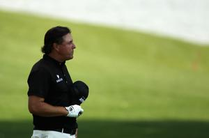 CHARLOTTE, NC - MAY 08:  Phil Mickelson observes a moment of silence for the passing of golf legend Seve Ballesteros during the final round of the Wells Fargo Championship at the Quail Hollow Club on May 8, 2011 in Charlotte, North Carolina.  (Photo by Scott Halleran/Getty Images)