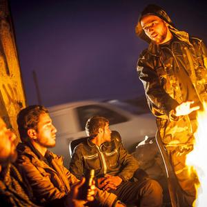 Syrian rebels gather around a fire in Aleppo (AP)
