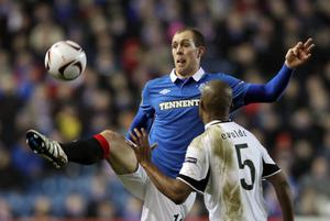 GLASGOW, SCOTLAND - FEBRUARY 17:  Steven Whittaker of Rangers and Evaldo of Sporting in action during the UEFA Europa League, round of 32, first leg match between Glasgow Rangers and Sporting at Ibrox Stadium on February 17, 2011 in Glasgow, Scotland. (Photo by Ian MacNicol/Getty Images)